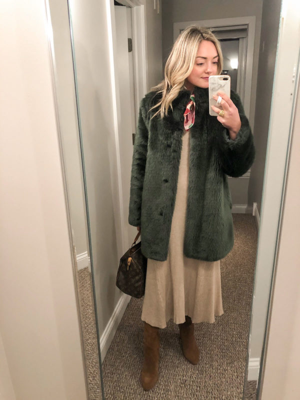 Chicago blogger Bows & Sequins styling a green faux fur coat over a ribbed sweater dress with a neck scarf and suede boots.
