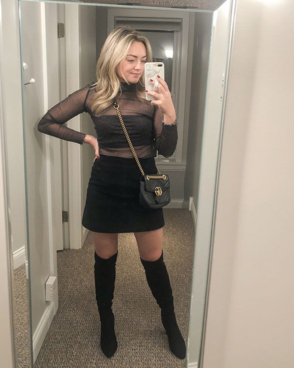 Fashion blogger styling a sheer top with a suede skirt, over the knee boots, and a Gucci bag for a night out at Tao in Chicago.
