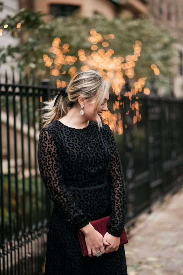 Chicago blogger Bows & Sequins styling a leopard dress for a holiday party.