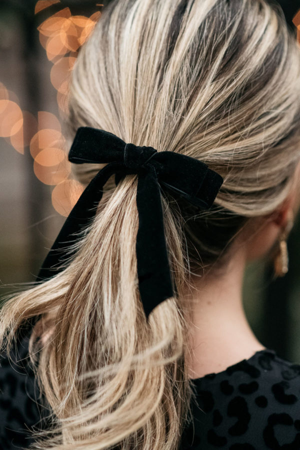 Feminine fashion blogger styling a J.Crew Velvet Hair Bow for the holidays.