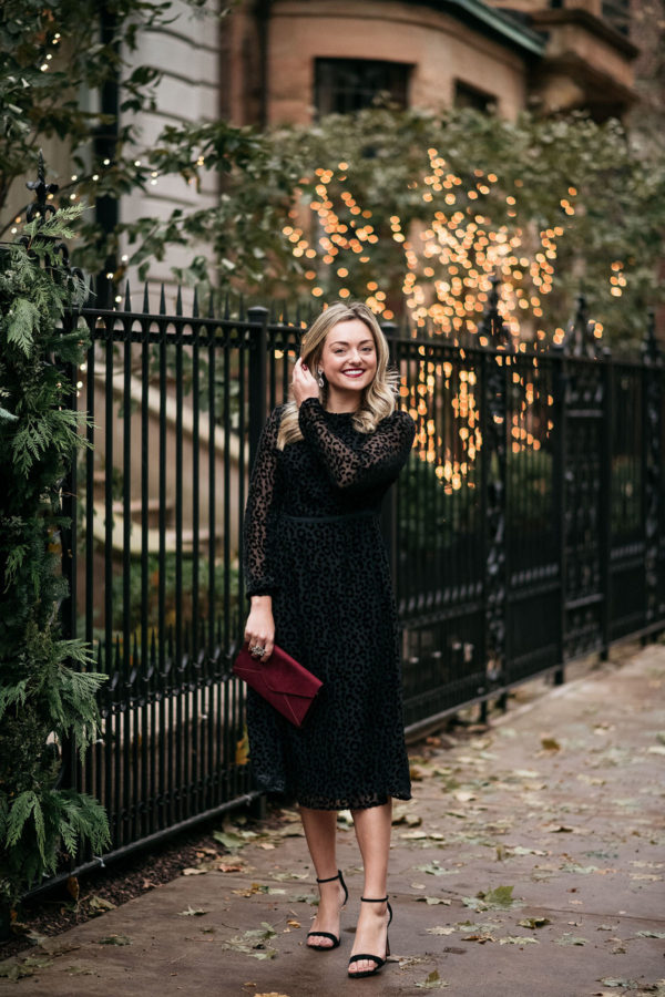 Chicago stylist Jessica Sturdy wearing a black leopard velvet dress for the holidays.