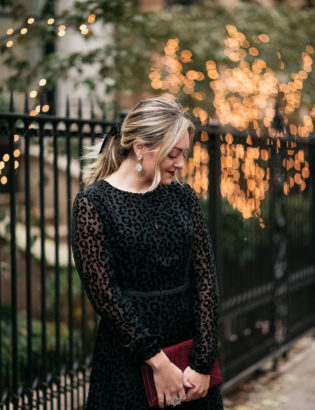 Fashion blogger Bows & Sequins wearing a classy leopard print dress with crystal statement earrings.