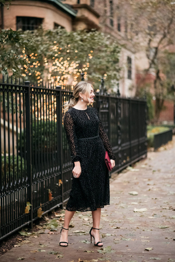 Fashion and lifestyle influencer Bows & Sequins styling a feminine velvet midi dress for the holidays.