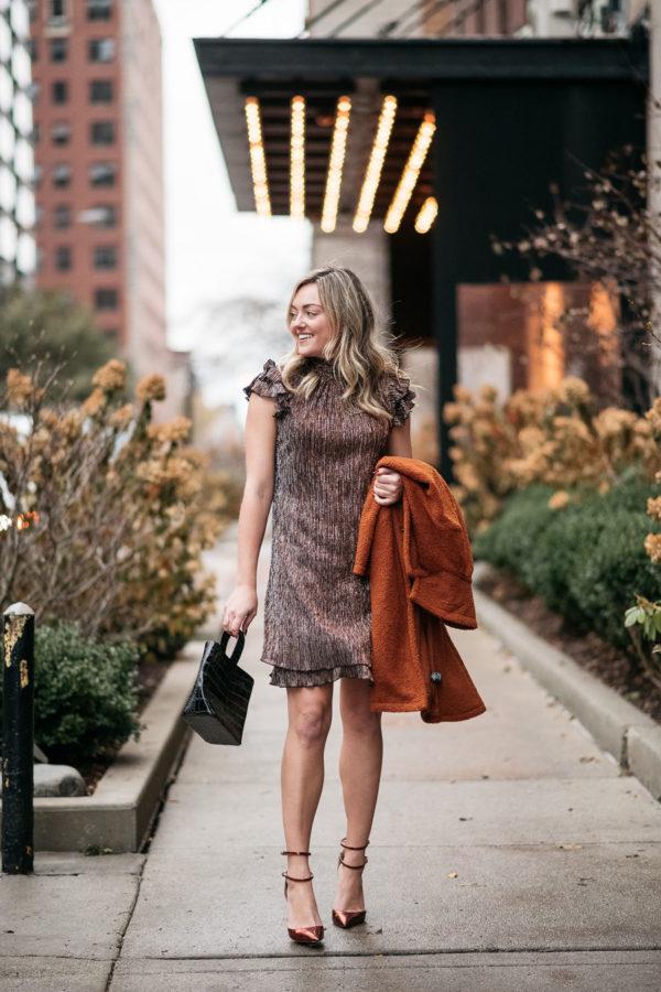 Chicago blogger styling a shimmery mock neck mini dress.