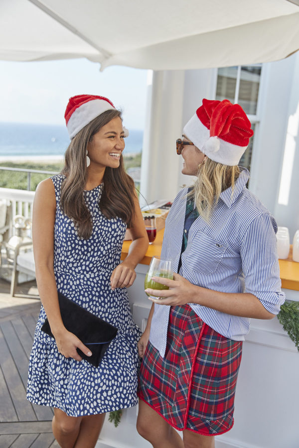 Caila Quinn and Jessica Sturdy wearing Santa hats with preppy Vineyard Vines outfits at the Veuve Clicquot Bar at Ocean House Rhode Island.