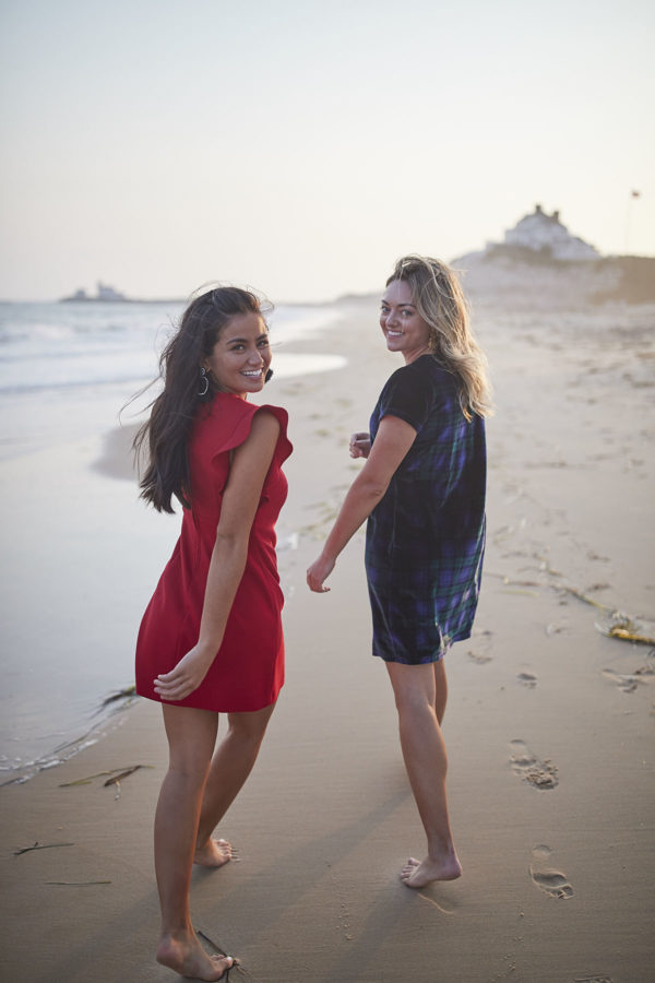 Bloggers Caila Quinn and Jessica Sturdy on the beach at sunset wearing Vineyard Vines holiday dresses.