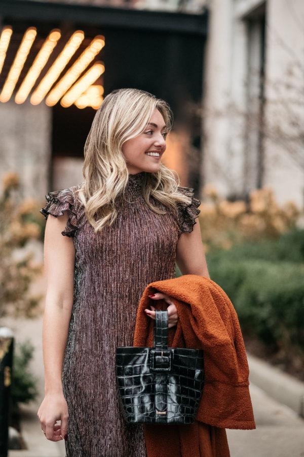 Fashion blogger carrying the Brahmin Faith bag.