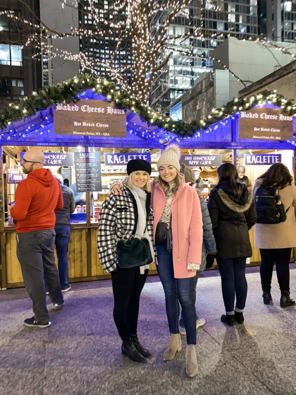 Kelly Chrischilles and Jessica Sturdy at Christkindlmarket Chicago wearing cute winter coats.