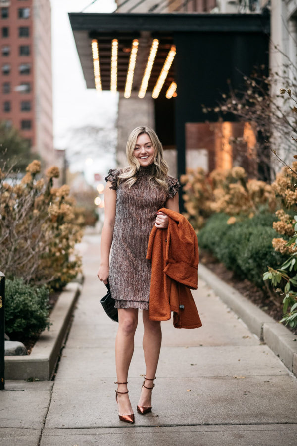 Chicago fashion blogger Bows & Sequins styling a shimmery mock neck dress.