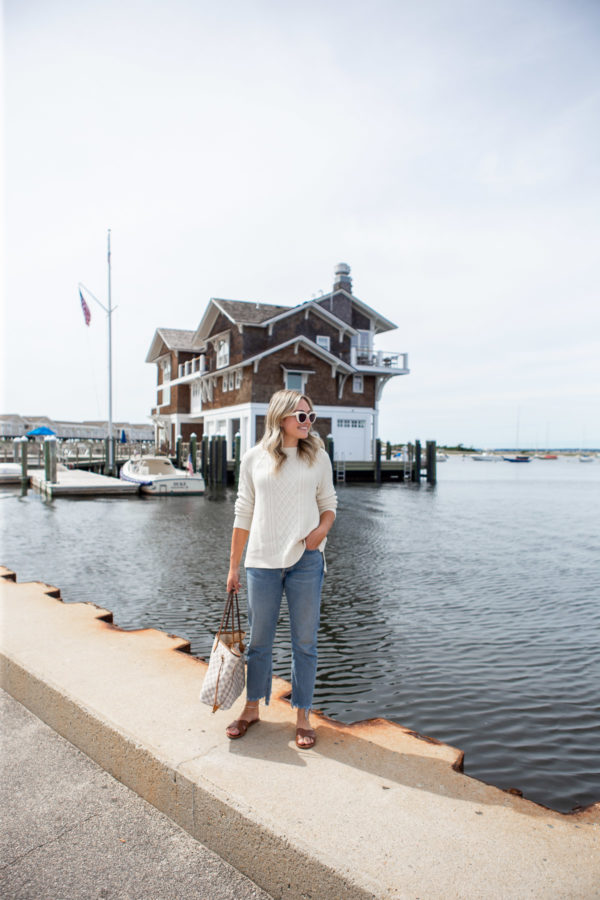 Fashion blogger Jessica Sturdy wearing a Vineyard Vines fisherman sweater and Citizens of Humanity Charlotte Crop Jeans in Watch Hill, Rhode Island.
