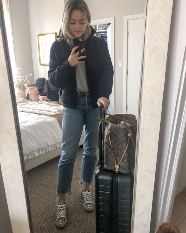 Travel Outfit: Black Fleece Bomber Jacket, Citizens of Humanity Charlotte Crop Jeans, Golden Goose Leopard Glitter Sneakers
