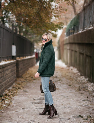 Chicago lifestyle influencer Jessica Sturdy wearing the Dudley Stephens Brooklyn Bomber with cropped jeans and brown ankle booties.