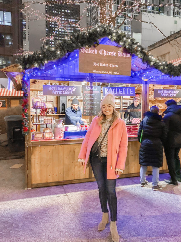 Bows & Sequins at Christkindlemarket in Chicago wearing a pink J.Crew Cocoon Coat and an Ulla Johnson Sweater.