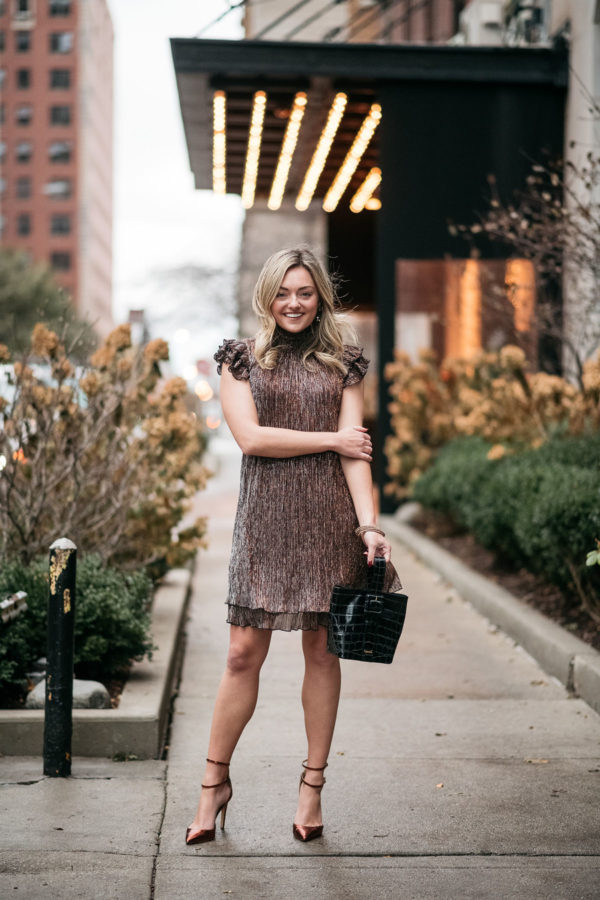 Chicago personal stylist Jessica Sturdy wearing a shimmery dress in front of The Ambassador Hotel in Chicago's Gold Coast.