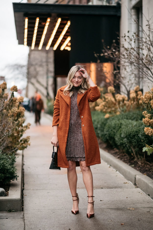 Chicago fashion blogger Jessica Sturdy of Bows & Sequins wearing a teddy coat and shimmery dress.