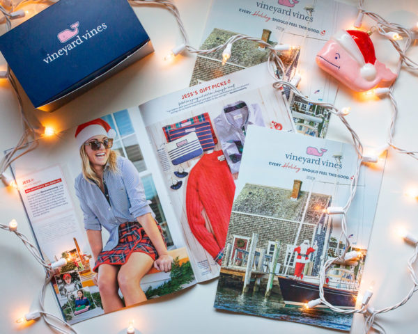 Chicago fashion blogger with an East Coast aesthetic, Jessica Sturdy, of the women's fashion and lifestyle blog Bows & Sequins styling a striped button down shirt with a plaid skirt at Ocean House Rhode Island Veuve Clicquot bar for the Vineyard Vines 2019 Holiday Magazine Shoot.