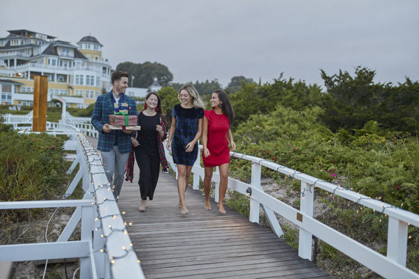 Lifestyle bloggers John Philp Thompson, Jennifer Lake, Jessica Sturdy, and Caila Quinn wearing Vineyard Vines running to the beach at Ocean House in Watch Hill, Rhode Island.