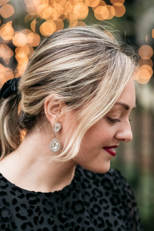 Fashion blogger Bows & Sequins styling Loren Hope Abba Crystal earrings.