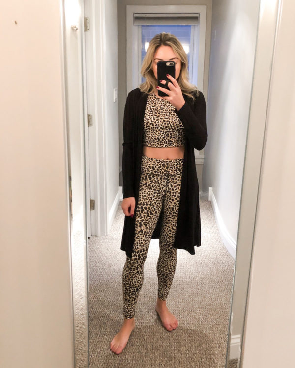 Chicago fitness blogger wearing a leopard print workout crop top and high waisted leggings set from Outdoor Voices with a black ribbed long duster cardigan.
