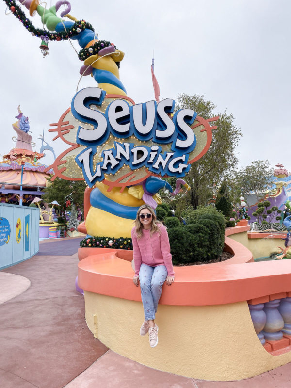 Travel blogger Jessica Sturdy of Bows & Sequins at Seuss Landing at Universal Studios in Orlando, Florida.