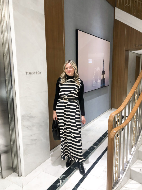 Chicago influencer Jessica Sturdy at Tiffany & Co. even on Michigan Avenue wearing a Stine Goya dress with a Gucci belt.