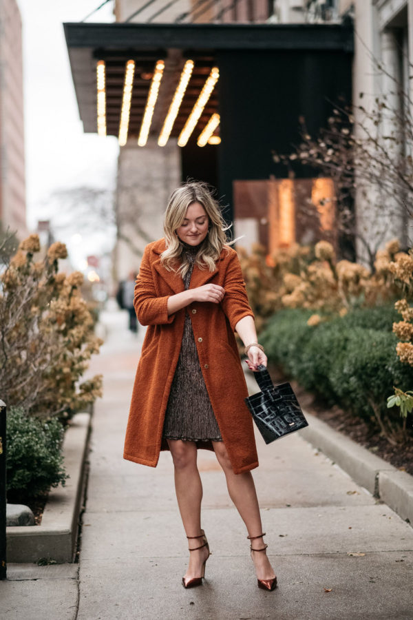 Chicago blogger wearing a teddy coat and party dress.