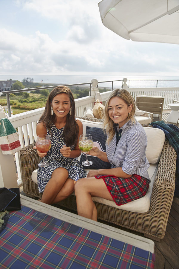 Caila Quinn and Jessica Sturdy modeling Vineyard Vines holiday collection at the rooftop bar at Ocean House Rhode Island.
