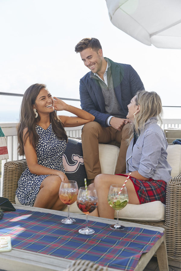 Bloggers Caila Quinn, John Philp Thompson, and Jessica Sturdy styling Vineyard Vines on a beachy rooftop bar in Rhode Island.