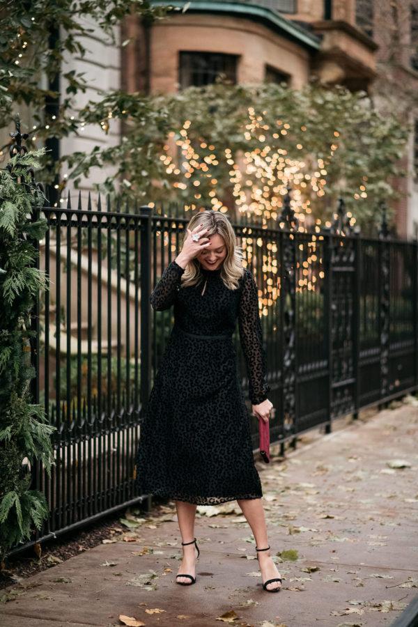 Fashion blogger with feminine style wearing a Boden black velvet leopard dress with Schutz ankle strap heels.