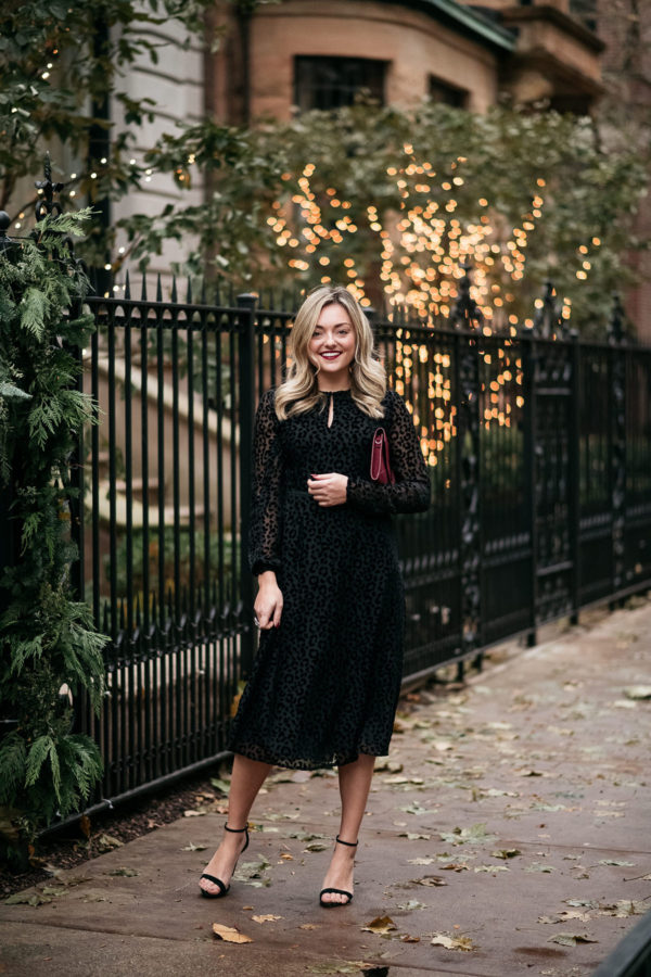 Chicago personal stylist Jessica Sturdy of Bows & Sequins styling a black velvet midi dress with classic ankle strap heels for a holiday Christmas party.