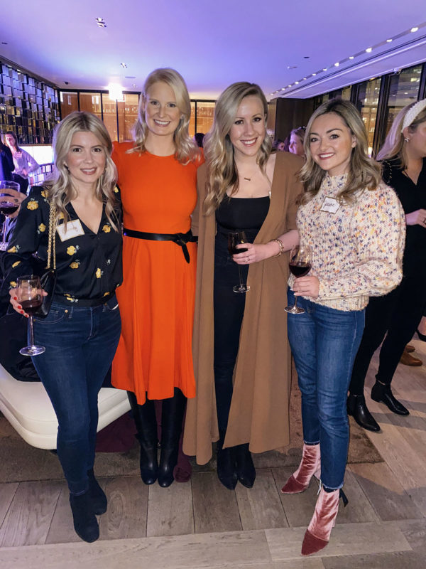 The Style Scribe Meetup in Chicago at The Langham's Travelle Lounge. Courtney Heath, Merritt Beck, Kate Kennedy, Jessica Sturdy. Jessica is wearing an Ulla Johnson puff sleeve rainbow Moxie sweater with kick flare jeans and Robert Clergerie pink velvet booties.