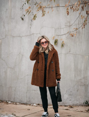 Chicago fashion blogger wearing an off duty look of a cozy jogger set with Vans sneakers and a brown teddy coat.