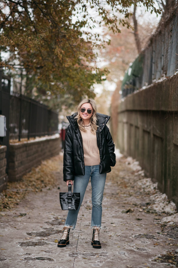 Fashion blogger wearing Nanushka Hide Vegan Leather Puffer Coat with Citizens of Humanity Jeans and Brahmin bag.