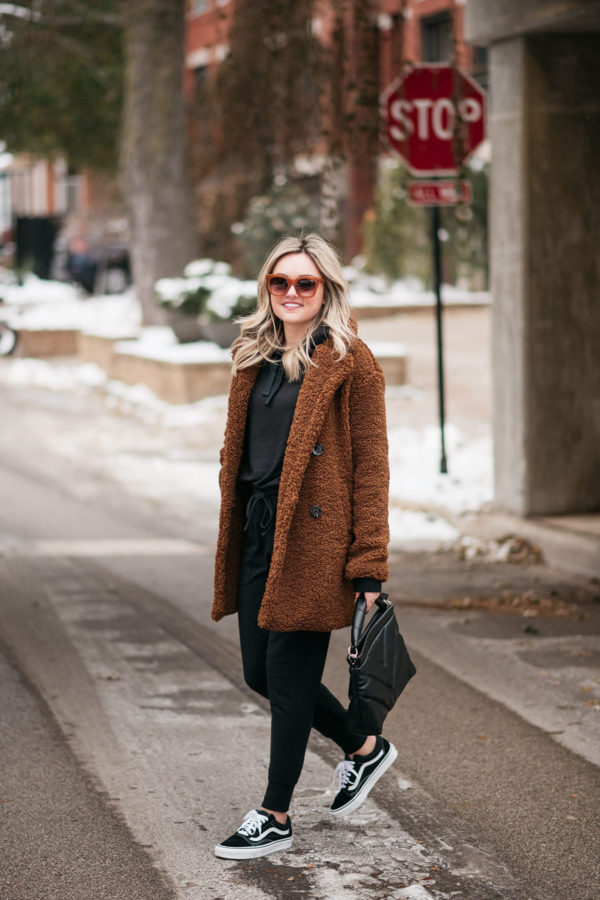 Casual style blogger Bows & Sequins wearing Vans sneakers with a teddy sherpa coat.