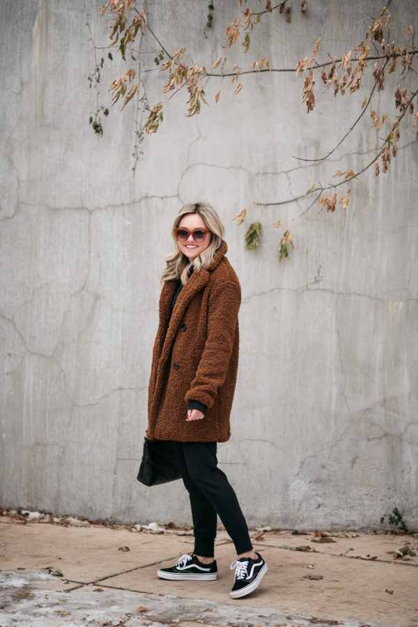 Fashion blogger Bows & Sequins styling a teddy coat with Vans.