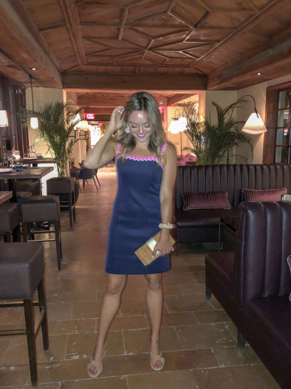 Jessica Sturdy wearing a navy and pink Lilly Pulitzer dress at Boulud at Brazilian Court in Palm Beach.