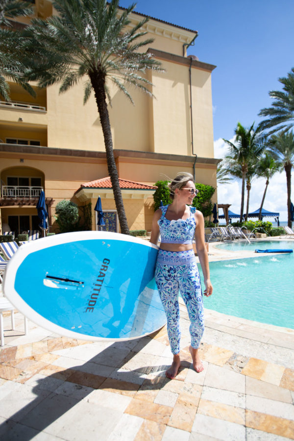Jessica Sturdy at Eau Palm Beach wearing a Lilly Pulitzer Crop Top and Leggings Workout Set for Stand Up Paddle Boarding.