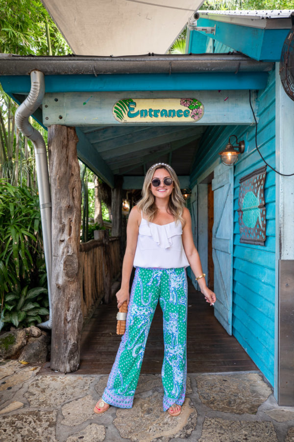 Jessica Sturdy wearing Lilly Pulitzer Cheetah Printed Palazzo Pants and Guanabana's in Florida with a pearl headband.