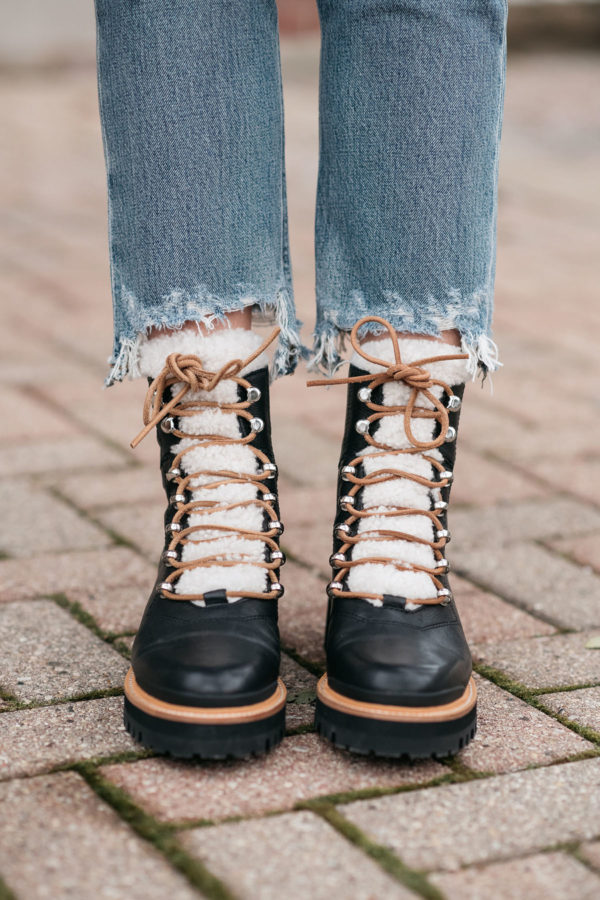 Fashion blogger styling Marc Fisher Izzie Booties in Black Leather with Raw Hem Jeans