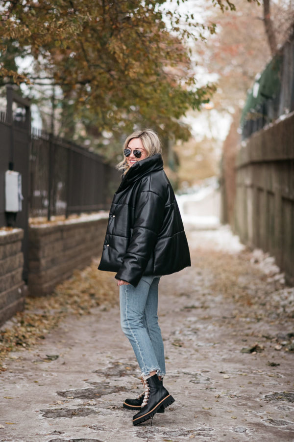 Chicago stylist Jessica Sturdy of Bows & Sequins wearing oversized leather puffer coat with jeans and leather shearling lace up hiker boots.