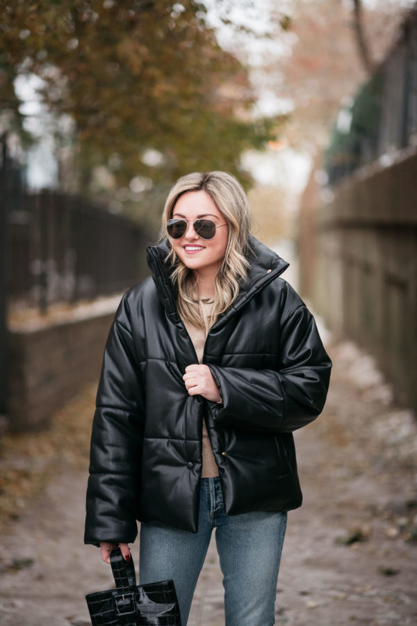 Style blogger Jessica Sturdy wearing Nanushka Leather Puffer Coat.