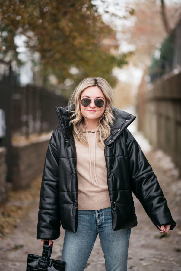 Fashion blogger wearing Nanushka Hide Vegan Leather Puffer Coat.