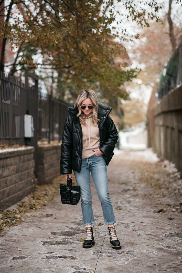 Chicago style influencer Jessica Sturdy of the lifestyle blog Bows & Sequins wearing leather puffer coat outfit with cropped jeans and shearling booties.