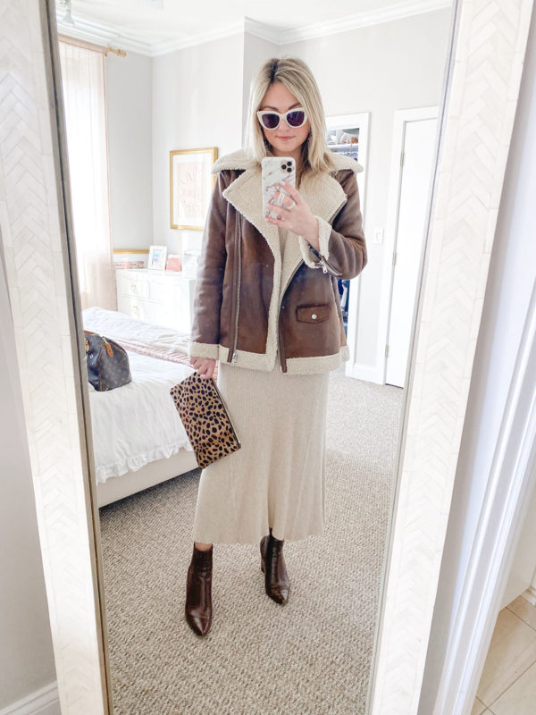 Chicago fashion blogger Jessica Sturdy of Bows & Sequins styling an Avec Les Filles moto jacket with a Mango ribbed maxi sweater dress, Clare V leopard clutch, Steve Madden Subtle brown croc booties, and Boden white sunglasses.