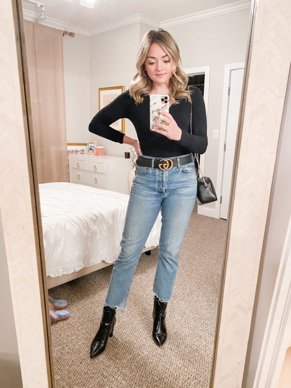 Fashion blogger styling a bodysuit with a Gucci belt and mom jeans for a date.