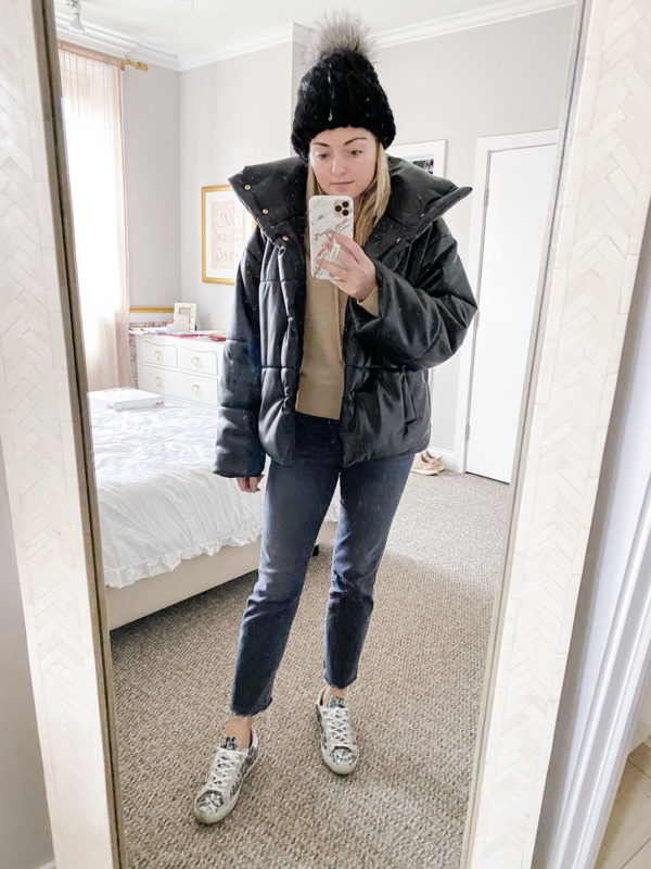 Chicago style blogger wearing a Nanushka vegan leather puffer jacket, a Kyi Kyi beanie, and Golden Goose glitter sneakers.