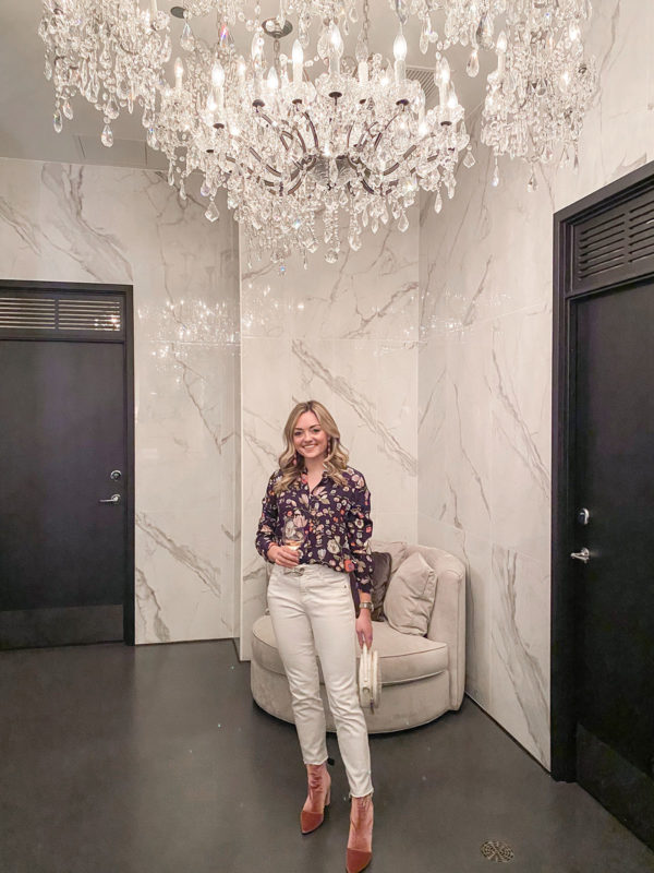 Fashion blogger wearing Rebecca Taylor floral silk blouse, Vineyard Vines white jeans, Roger Clergerie pink velvet booties, and Brahmin round handbag at The Dalcy in Chicago.