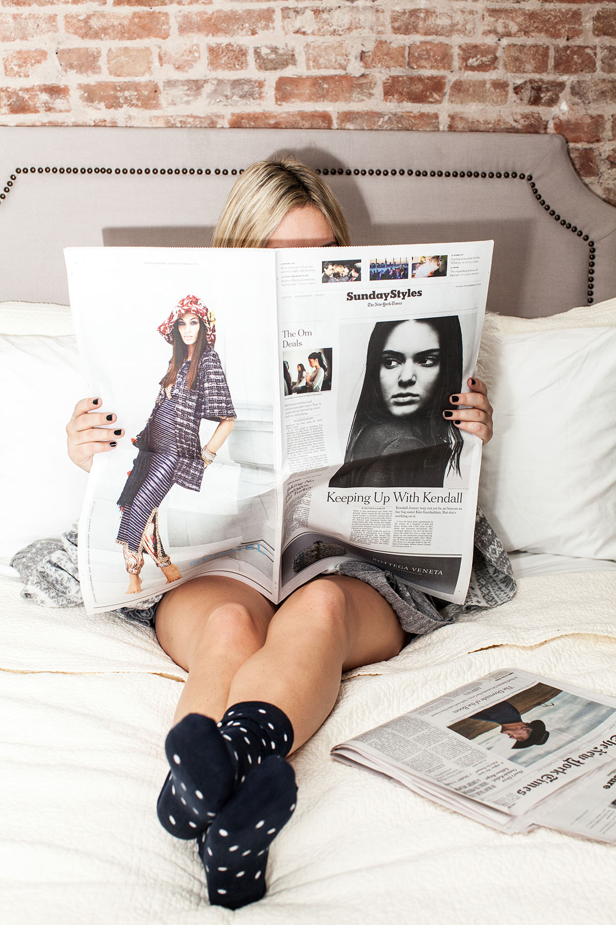 Lifestyle blogger Jessica Sturdy of Bows & Sequins reading the New York Times Sunday Styles in bed.