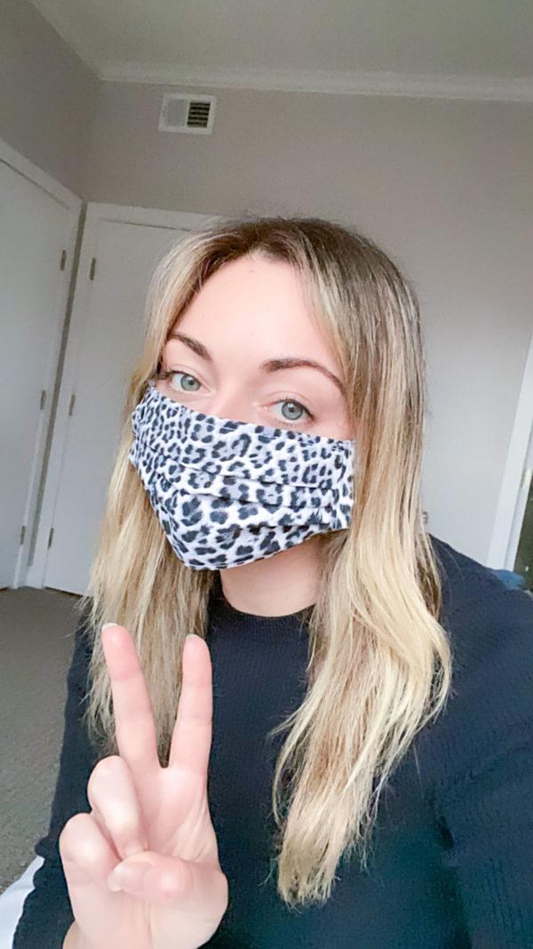 Fashion blogger wearing a leopard face mask.