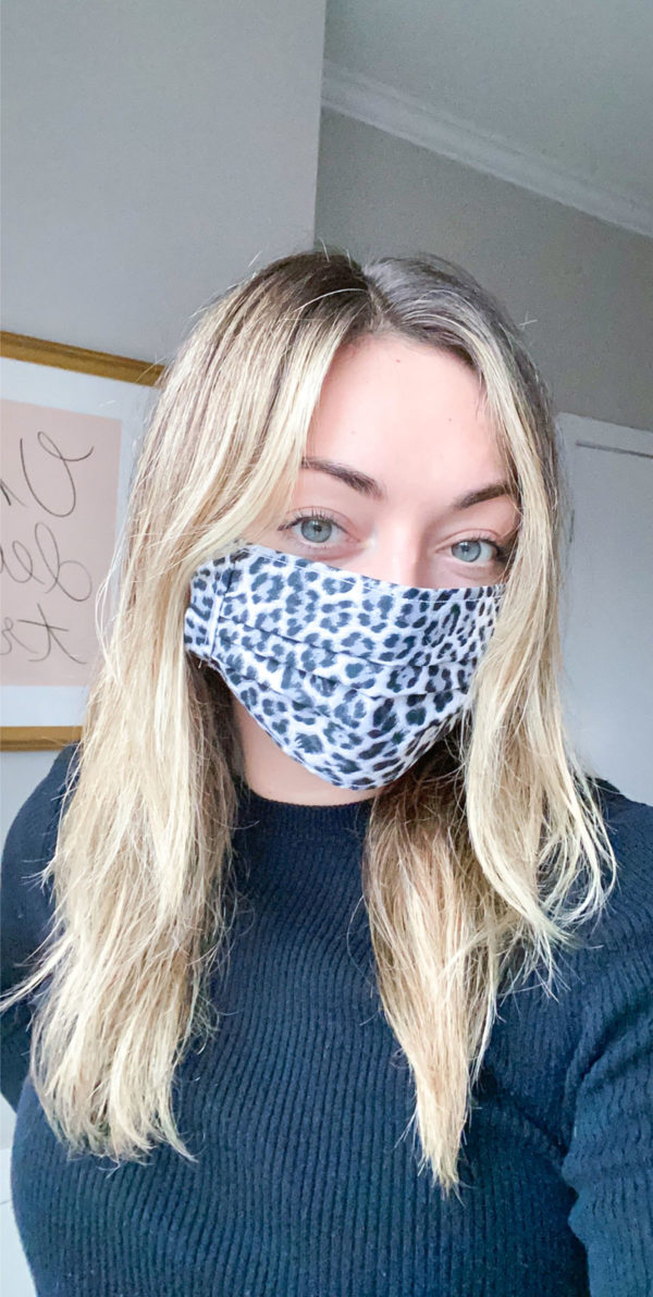 Chicago influencer wearing a black and white leopard face mask.